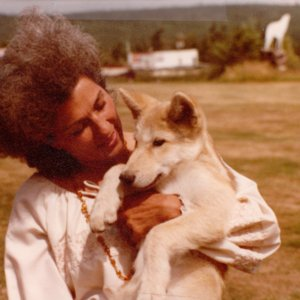 Mary Wheeler Holding a Wolf Pup at Jack Lynch's Wolf Sanctuary in Gardiner, WA [Photograph]