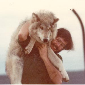 John Holland and Idiot Elliot at Jack Lynch's Wolf Sanctuary in Gardiner, WA [Photograph]