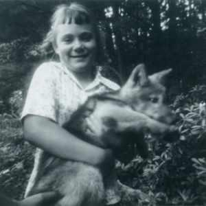 Leora Hoge Holding a Wolf Named Wendy [Photograph]