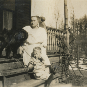Margaret Jones, a Boy, and a Dog on the Porch of the Jones' House [Photograph]