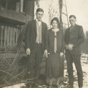 Three People in Front of the Jones' House [Photograph]