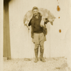 Man with a Dead Wolf [Photograph]