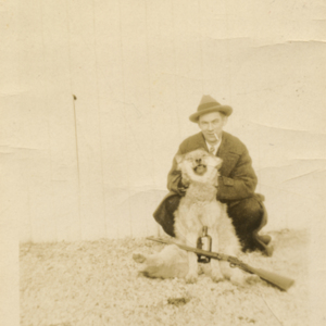 Man with a Dead Wolf, Gun, and Whiskey [Photograph]