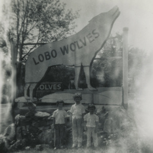 lobo wolves sign - from left to right Donna, Theresa, and Janet Staricek.jpg